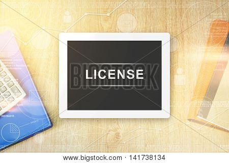 license word on tablet with soft light vintage effect