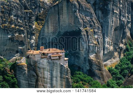 Meteora Greece. Mountain scenery with Meteora rocks and Roussanou Monastery landscape place of monasteries on the rocks orthodox religious greek landmark in Thessaly