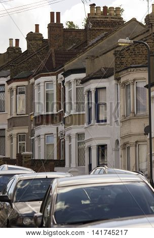 LONDON, UNITED KINGDOM - SEPTEMBER 12 2016: Traditional british houses in a row with car parked on the street in the suburb of Woolwich Arsenal London