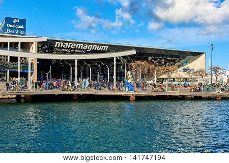 Barcelona Spain - April 3 2016: Crowd of people in the Rambla de Mar in Barcelona city. The Ramla del Mar is a main tourist attraction it has a leisure center shops restaurants IMAX cinema and an aquarium. Barcelona. Spain