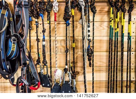 background with colorful ropes and carabiners hung on wooden wall