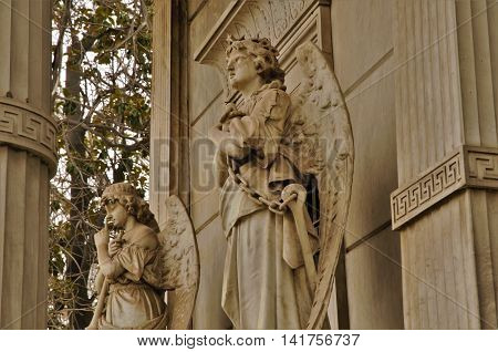 Close-up of statues of praying angels on the cemetery in Santiago de Chile