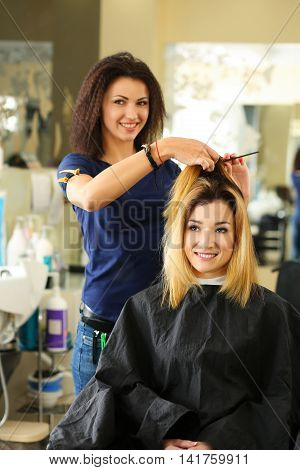 Beautiful Blonde Hairdresser Hold Comb