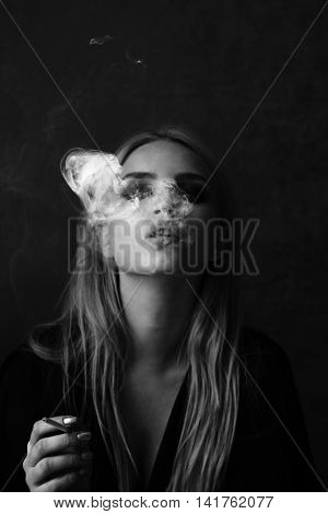 Sexy Woman With Smoky Eyes Makeup Smoking