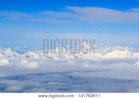 Mountain alps panorama with Matterhorn Mont Blanc and clouds