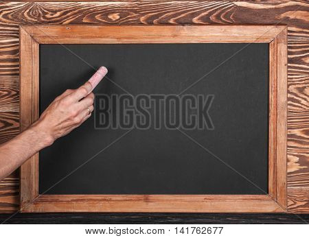 School Board And Hand With Piece Of Chalk