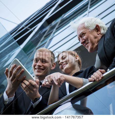 Businesspeople Looking At The Tablet