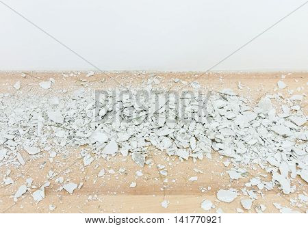 White siemens scrap on the laminate flooring from the drilling wall .