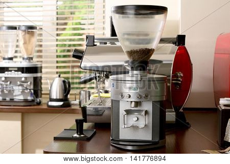 Modern coffee mill on wooden table