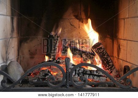 Burning Vintage Fireplace Fire in a fireplace fire flames on a black background Firewood burning in fireplace fire heat red ashes interior