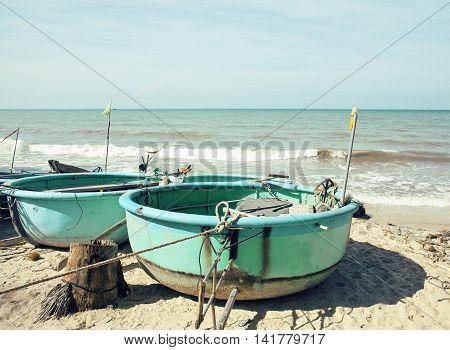 lot of fishermens boats at seacoast sunrise horisont sea among palms