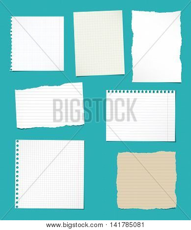 Set of ripped white and brown ruled, math notebook paper are stuck on blue background.