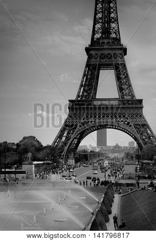 Paris, France - May 21, 2016: Tourists are enjoying the pleasant spring weather around the Eiffel Tower ahead of  the full tourist season and summer heat waves. Black and white.