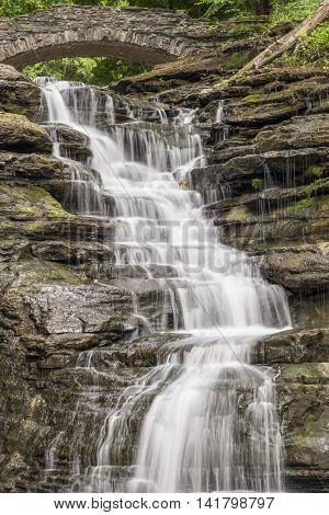 Whitewater tumbles down Stewart Falls a cascading waterfall in the Cascadilla Gorge on the Cornell University campus in Ithaca New York.