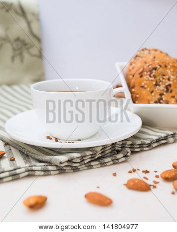 coffee cup on the table with white cup with biscuits