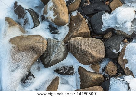 background stones on the bank of ice