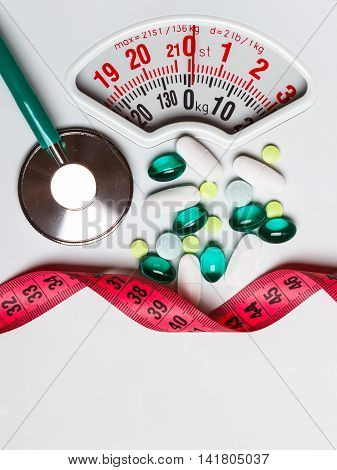 Pills Stethoscope Measuring Tape On Scales. Health Care