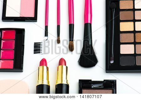 Cosmetic tools placed on the white background