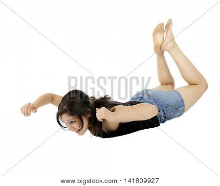 An attractive young teen falling (or floating) in space.  Isolated on white.
