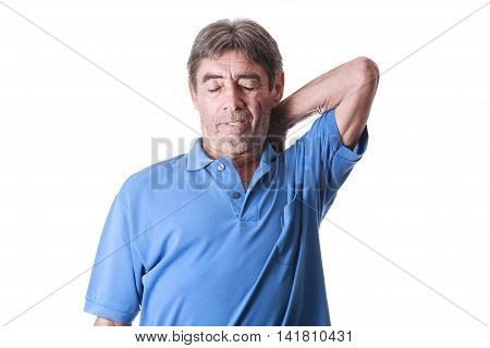 Portrait Of Senior Man Suffering With Back Pain
