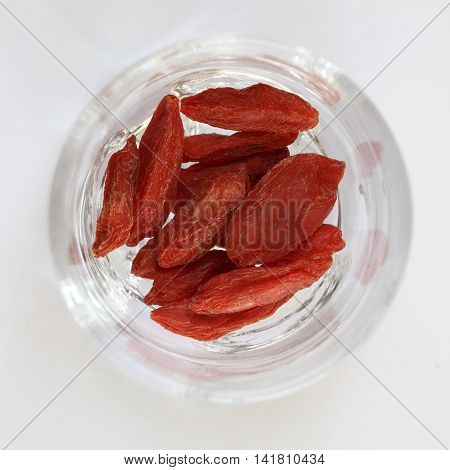 A glass full of natural dried goji berries.