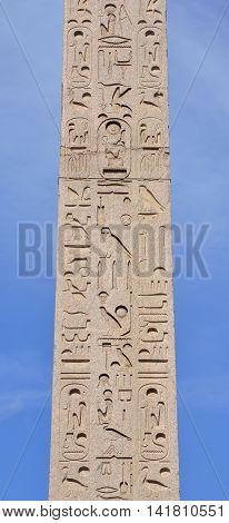 Hieroglyph script on ancient egyptian obelisk in the center of Piazza del Popolo square