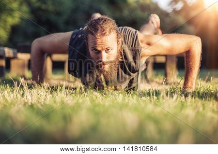 Training Outdoors. Handsome Sport Man Doing Pushups.