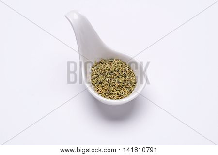 Monotone crushed Rosemary 1 tablespoon in a white spoon on the white background