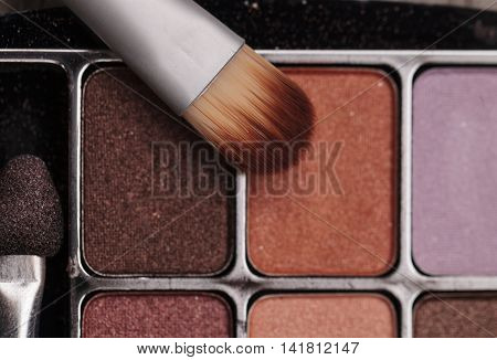 Natural soft Makeup brush on a textured rustic background