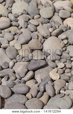 Smooth grey stone textured background  in summer