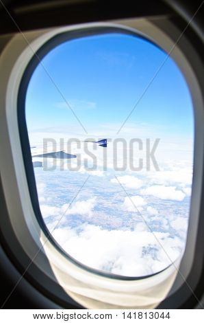 Earth and airplane wing viewing from a plane
