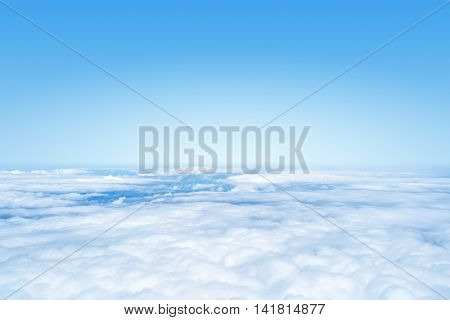 An image of a flight over the clouds background