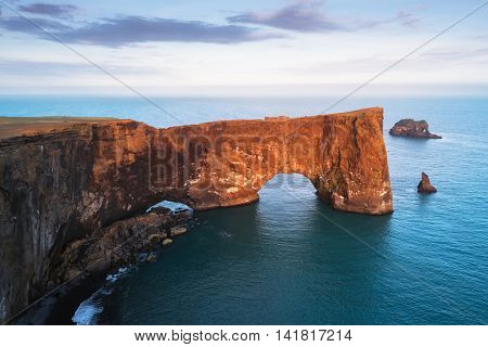 Beautiful summer landscape with rocky cape and ocean. Southern coast of Iceland. View of peninsula Dyrholaey, not far from the village V�­k. Art processing of photographs, color toning