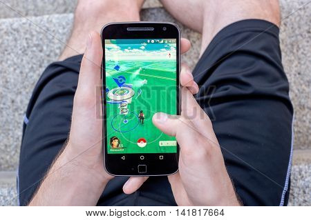 Montreal CA - August 7 2016: Closeup of a man playing Pokemon Go on a smart phone. Pokemon Go is a virtual reality game released in July 2016.