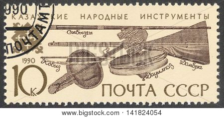 MOSCOW RUSSIA - CIRCA APRIL 2016: a post stamp printed in the USSR shows Kazakh folk musical instruments the series