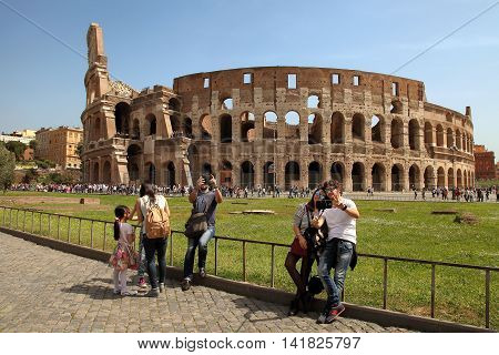 Rome Italy - April 7 2016: Tourists make selfie in the background Coliseum on APRIL 7 2016 in Rome Italy. The Colosseum is a major tourist attraction in Rome