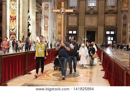 Rome Italy - APRIL 10 2016: Groupe of pilgrims are visiting St Peter basilica Vatican City Rome Italy