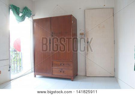 Old wood wardrobe in empty room, old room