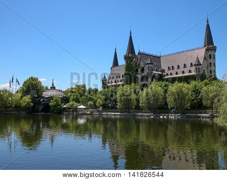 a beautiful castle on the lake in sunny day