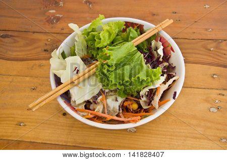 Fresh salad on table wood, top view