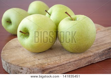 Ripe big green apples on wooden background