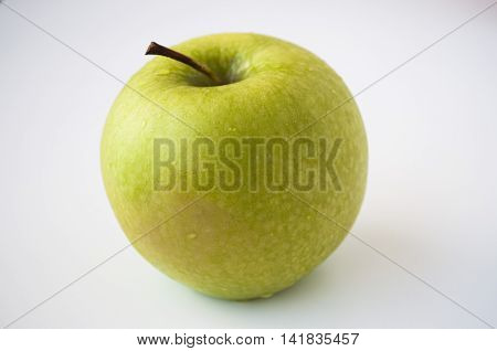 Big green apple, isolated on white background