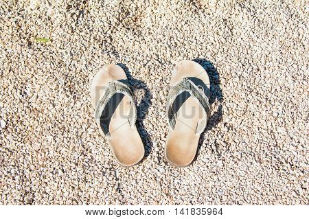 Flip Flop slippers on sandy beach, summertime, Croatia, island of Cres