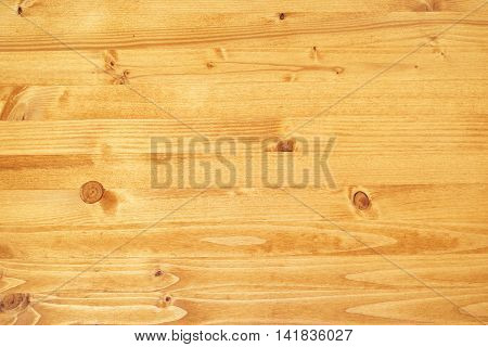 Yellow painted wooden board texture top view