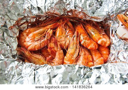 bunch of steamed shrimps in foil, top view