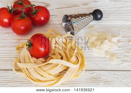 Homemade Pasta Spaghetti, Tomatoes And Parmesan