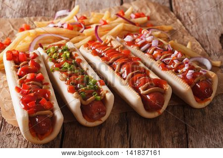 Hot Dogs With Ketchup, Mustard And French Fries Close-up. Horizontal