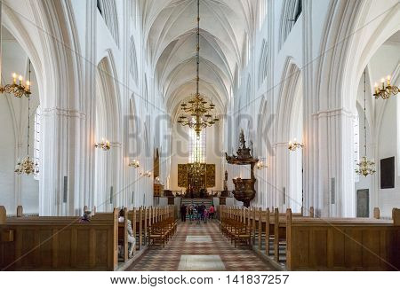 Odense Denmark - July 21 2015: The nave of the gothic St. Canute's Cathedral