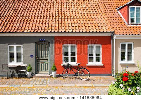 Odense Denmark - July 21 2015: A traditional house with bycicle in the old town