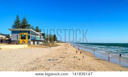 Adelaide Australia - February 7 2016: People relaxing at Henley Beach on a warm sunny day.
